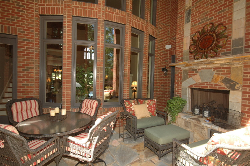 A deck remodel with outdoor fireplace and stone flooring