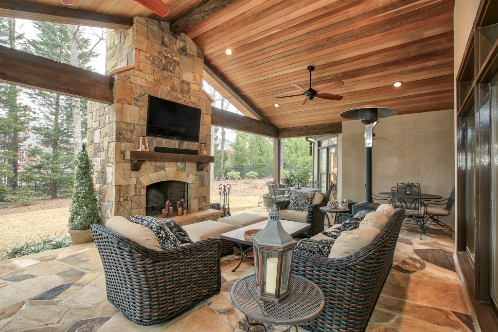 An covered porch/ patio renovation with outdoor fireplace