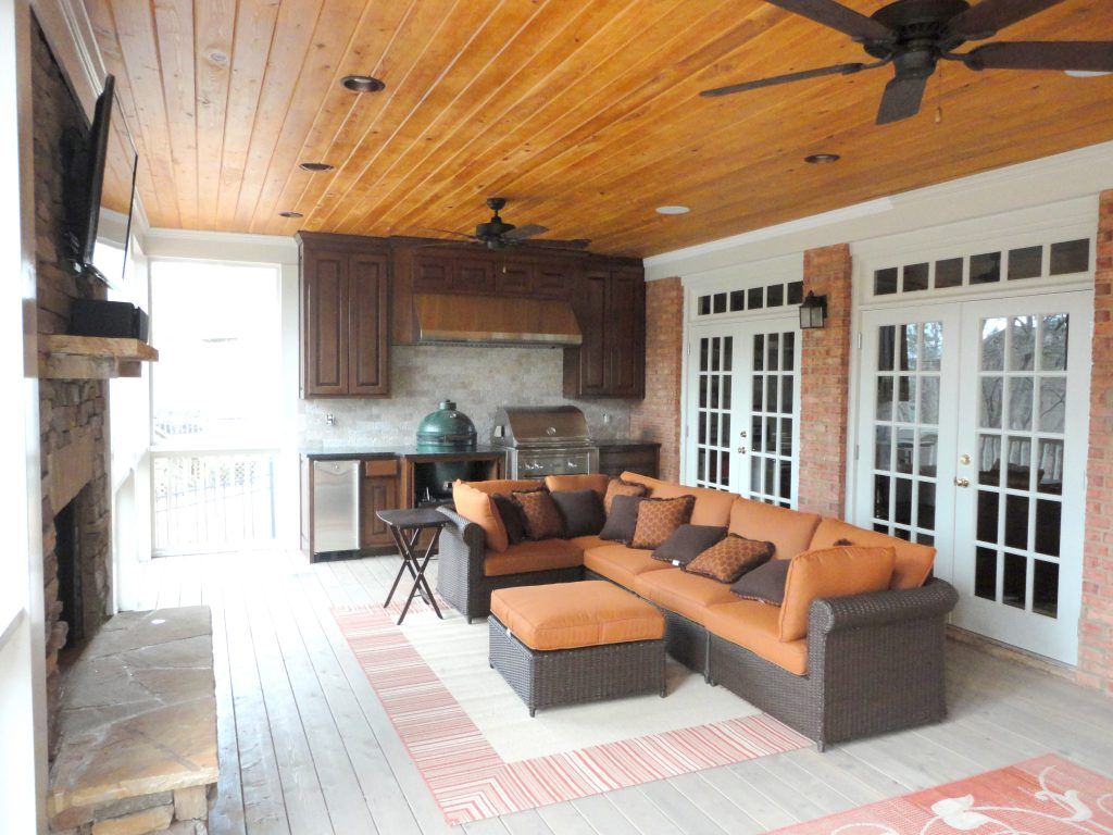 Backyard covered deck remodel including built-in grill and outdoor fireplace
