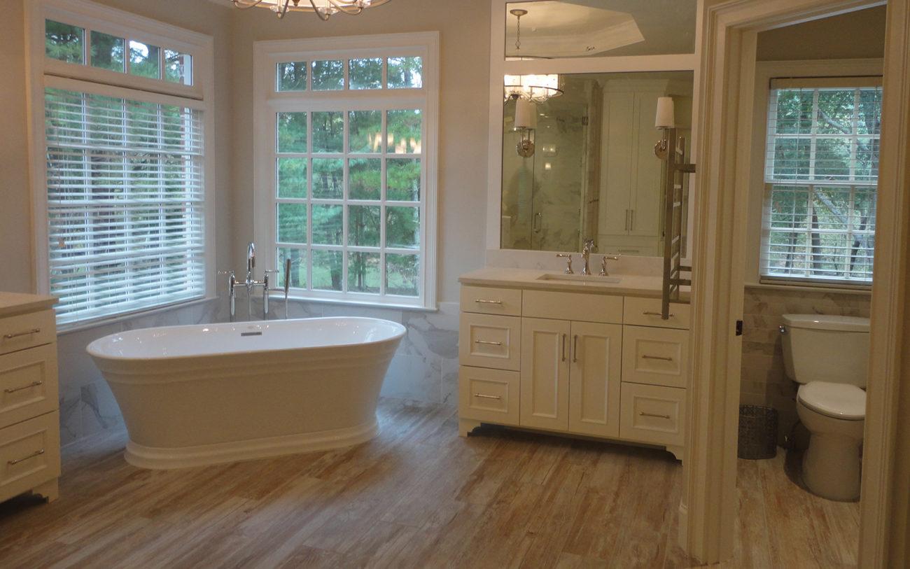 A cozy tub in a remodeled master bathroom